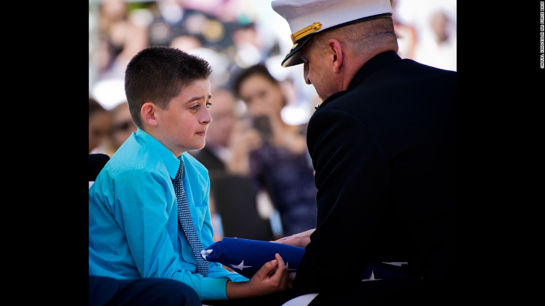 Ethen Lyon, son of Marine Staff Sgt. David Lyon, receives a folded flag during a memorial service at Florida's Eglin Air Force Base on Saturday, May 7. Ethen's father was killed in Afghanistan while serving as an explosive-ordnance disposal technician.
