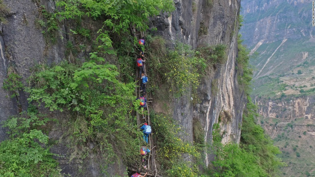 Atule'er, a village in China's Sichuan province, received widespread attention after state-run Beijing News published a series of photos of students climbing vine ladders along a 800-meter (half-mile) cliff to go to school.<br />