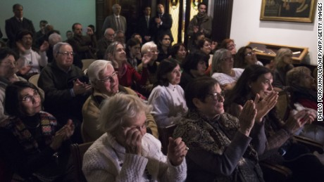 Relatives and victims of Argentine and Uruguayan militar dictatorships react as they hear the sentence of Argentina's court in the trial on Operation Condor, at the Argentina's embassy in Montevideo on May 27, 2016.  An Argentine court convicted 15 South American ex-military officers Friday for conspiring to torture and kill leftist dissidents during a US-backed crackdown by the region's dictatorships in the 1970s and 1980s. The court was the first to try atrocities committed under Operation Condor, a coordinated plan of repression launched at the height of the Cold War by the military regimes of Argentina, Bolivia, Brazil, Chile, Paraguay and Uruguay. It sentenced former Argentine dictator Reynaldo Bignone to 20 years and retired Uruguayan colonel Manuel Cordero -- the only non-Argentine national in the dock -- to 25 years. / AFP / PABLO PORCIUNCULA        (Photo credit should read PABLO PORCIUNCULA/AFP/Getty Images)