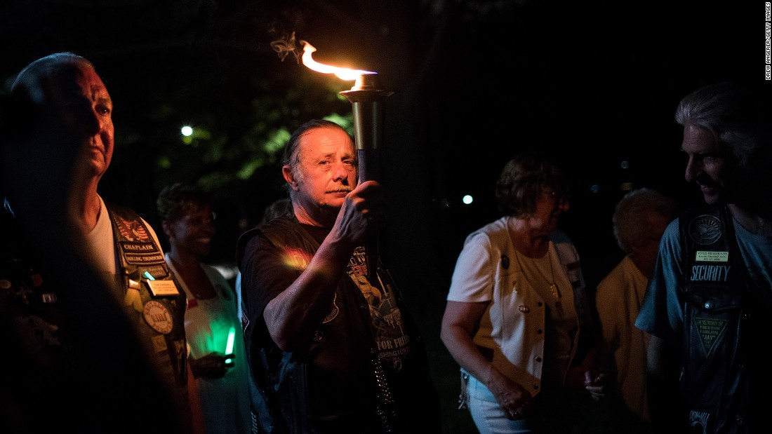 Joe Bean, vice president of Rolling Thunder, carries a torch near the Vietnam Veterans Memorial in Washington on May 27.