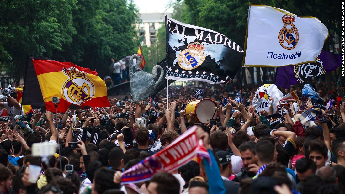 Real Madrid fans cheer for their team outside the Santiago Bernabeu stadium before the UEFA Champions League Final match between Real Madrid and Atletico Madrid.