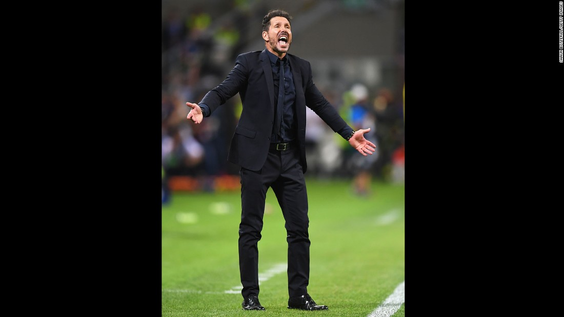 Atletico Madrid head coach Diego Simeone urges on his team.