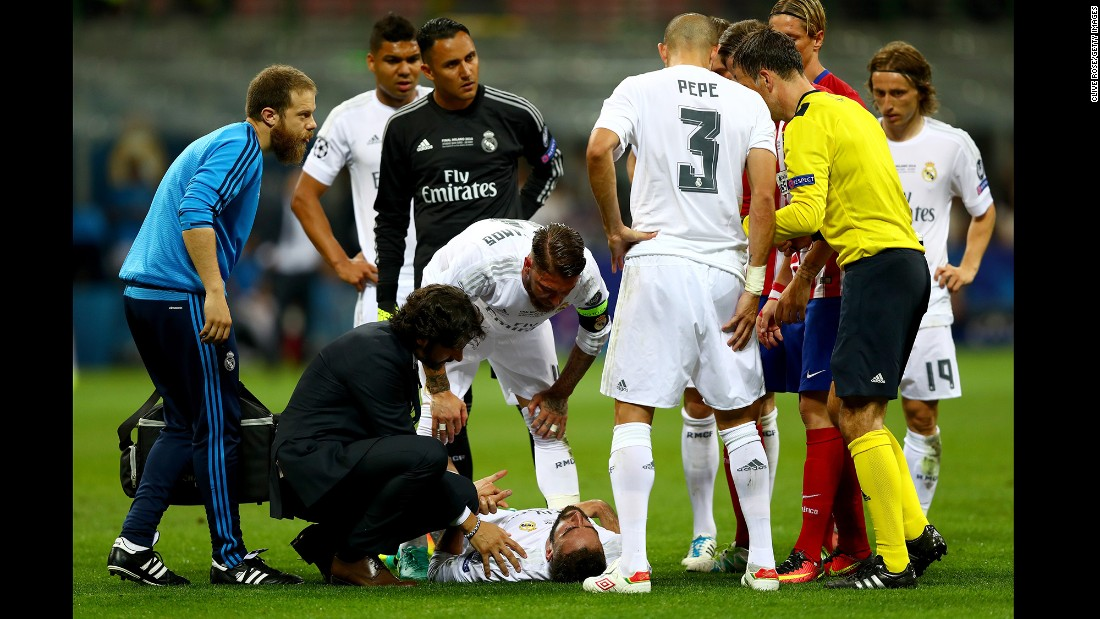 Dani Carvajal of Real Madrid lies injured on the pitch.
