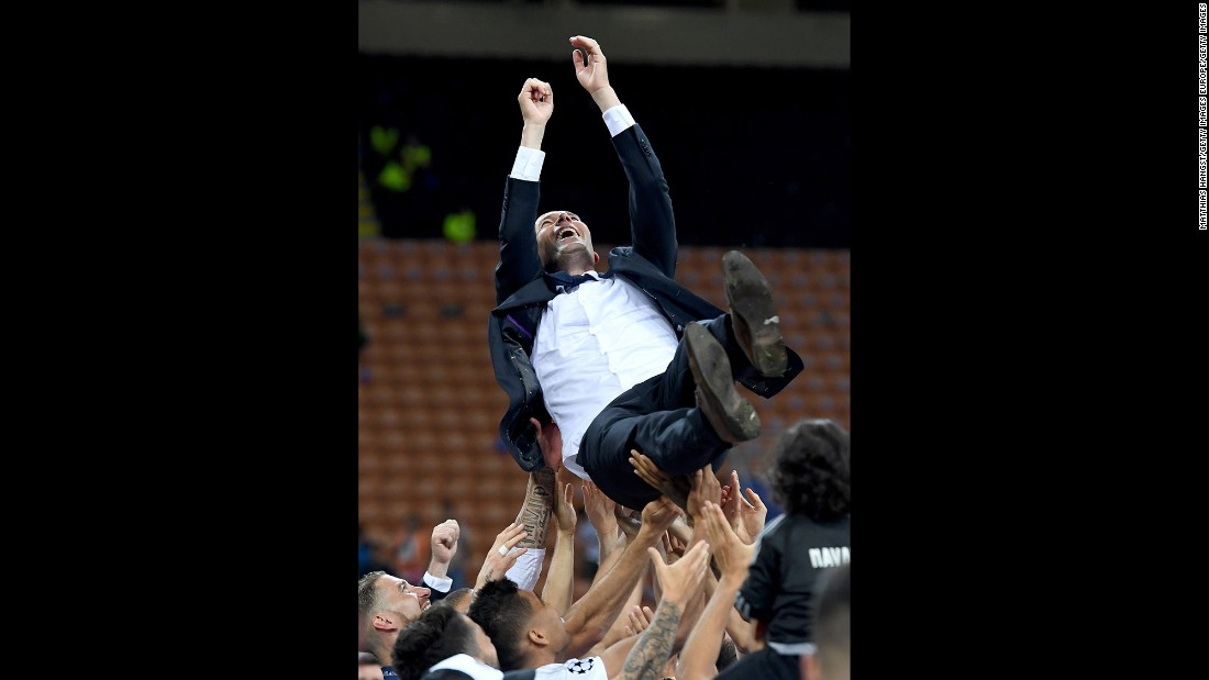 Real Madrid head coach Zidane is thrown in the air after the win.