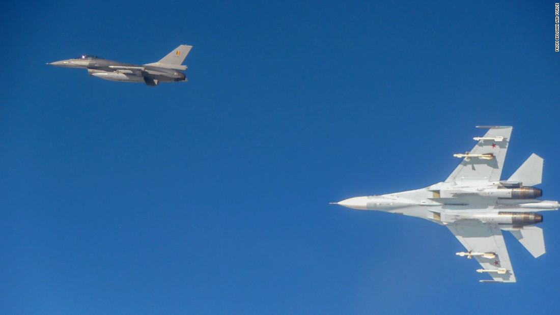 A Russian Su-27 turns away from a Belgian F-16.