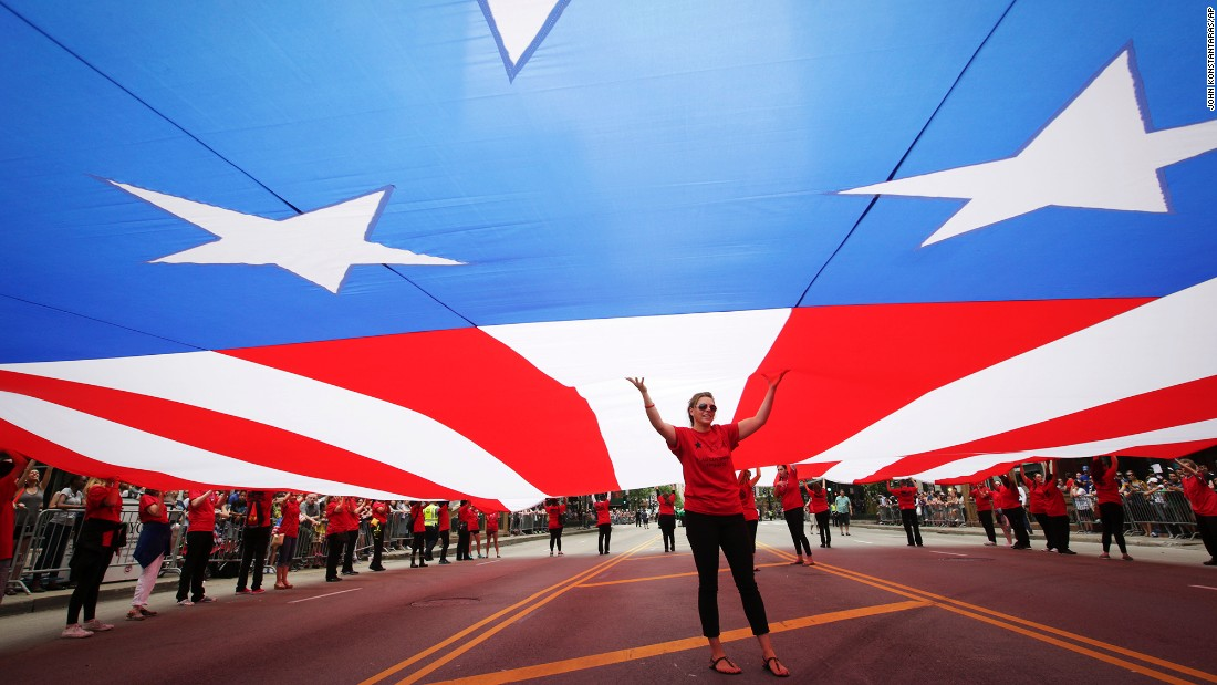 People hold up the world's largest American flag during the Chicago Memorial Day Parade on May 28. The 5,000-square-foot flag is nearly 100 years old.