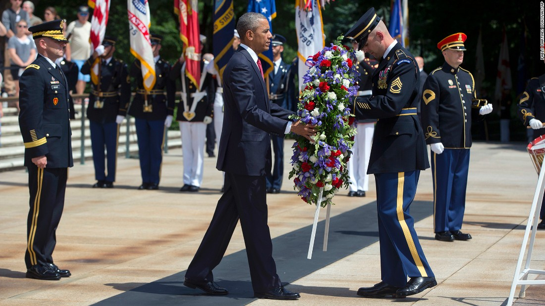 U.S. President Barack Obama lays a wreath at the Tomb of the Unknowns in Arlington, Virginia, on Monday, May 30.