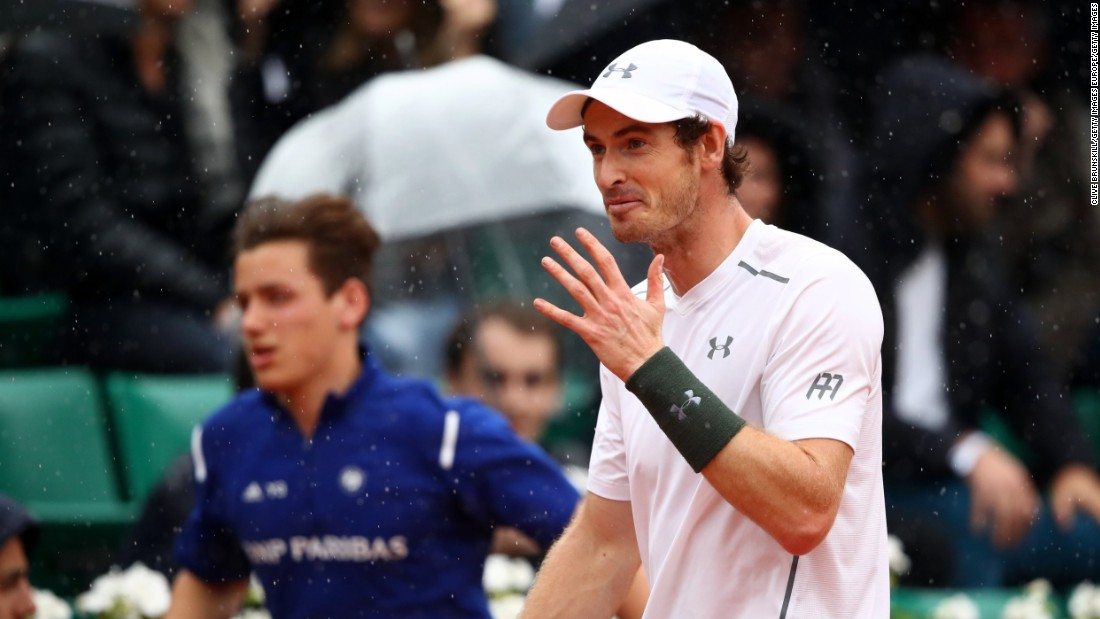 Much of the tournament has been blighted by weather this year. Andy Murray walked off court as rain stopped play during his May 29 fourth-round match against John Isner of the United States.