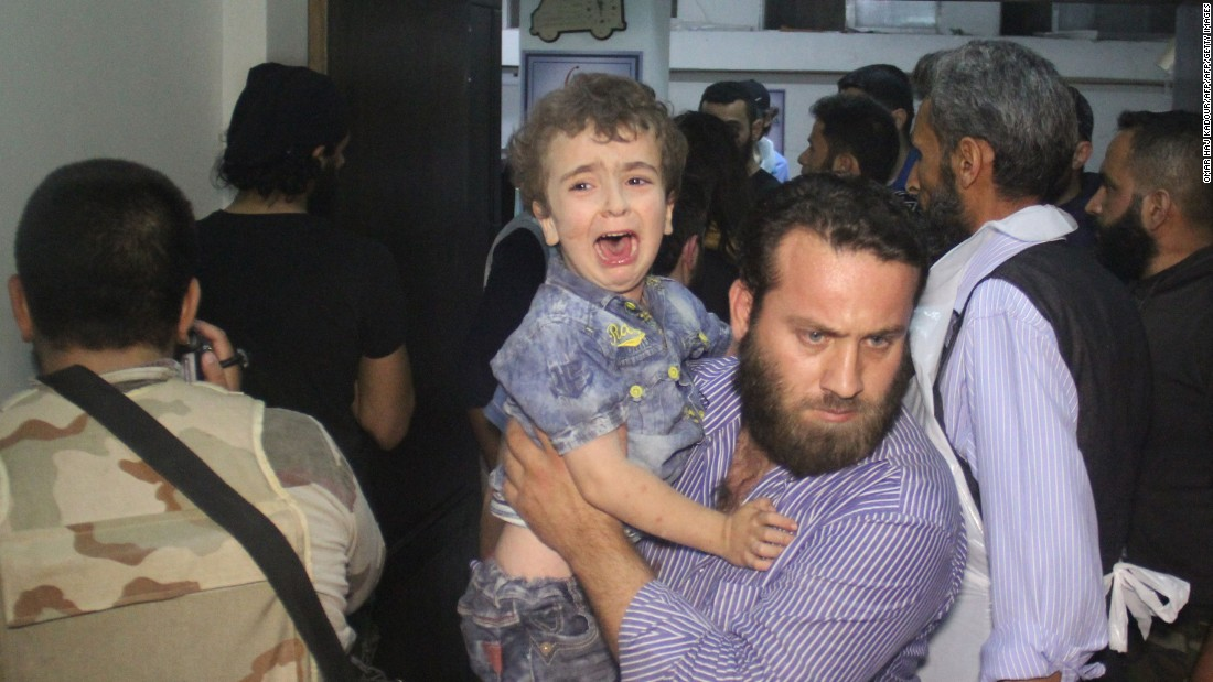 Children caught in the firing line as airstrikes target Syrian city