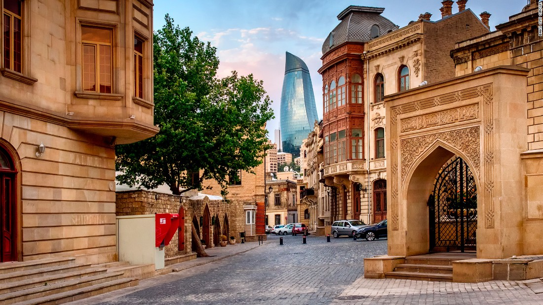 Baku prides itself on being a city that combines the historic and modern. Here, one of the city's famous Flame Towers peeps between the walls of the old city.