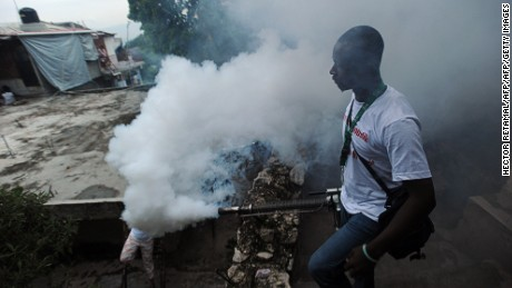 A worker from Haiti's  Ministry of Public Health and Population sprays chemical to exterminate mosquitoes in a neighborhood of Petion Ville in Port-au-Prince on May 21, 2014.  A worker said the procedure is to help prevent chikungunya, dengue, malaria and filariose.    AFP PHOTO / Hector RETAMAL        (Photo credit should read HECTOR RETAMAL/AFP/Getty Images)