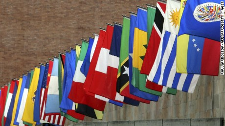 A worker prepares the flags of the Organization of American States (OAS) outside a press conference on May 30, 2008 in Medellin. The 38th regular session of the OAS General Assembly will be held from June 1 to 3 in Medellin, Colombia. AFP PHOTO/Raul ARBOLEDA (Photo credit should read RAUL ARBOLEDA/AFP/Getty Images)