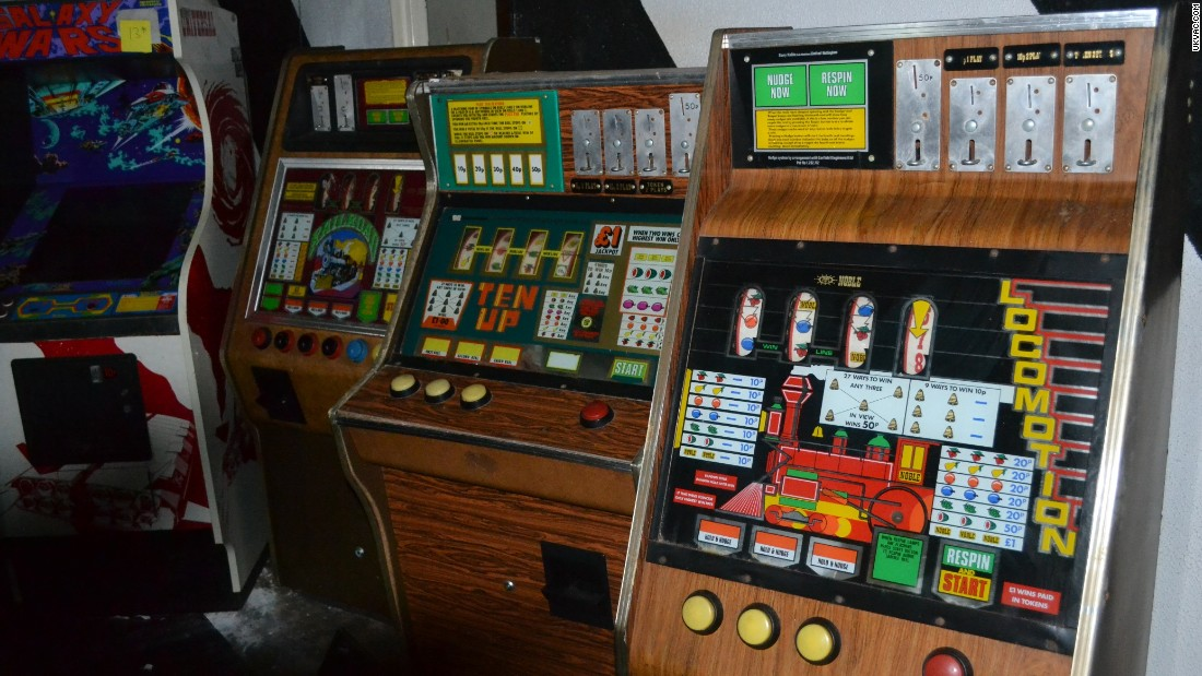 Oliver Moazzezi discovered a treasure trove of vintage arcade machine games on the lower deck of a disused ship.  The Duke of Lancaster, a vast 4,000 ton cruise liner lays beached on a river bank in the town of Mostyn, north east Wales, UK. With the help of fellow arcade machine enthusiasts, Moazzezi set about rescuing the abandoned machines.  These classic fruit machines have a distinctive walnut colored frontage.