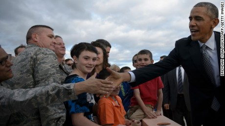 US President Barack Obama is greeted upon arrival at Peterson Air Force Base June 1, 2016 in Colorado Springs, Colorado.