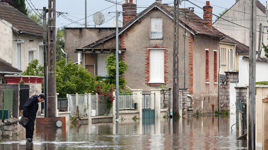 A man maneuvers through a flooded street in Nemours, south of Paris, on June 3.