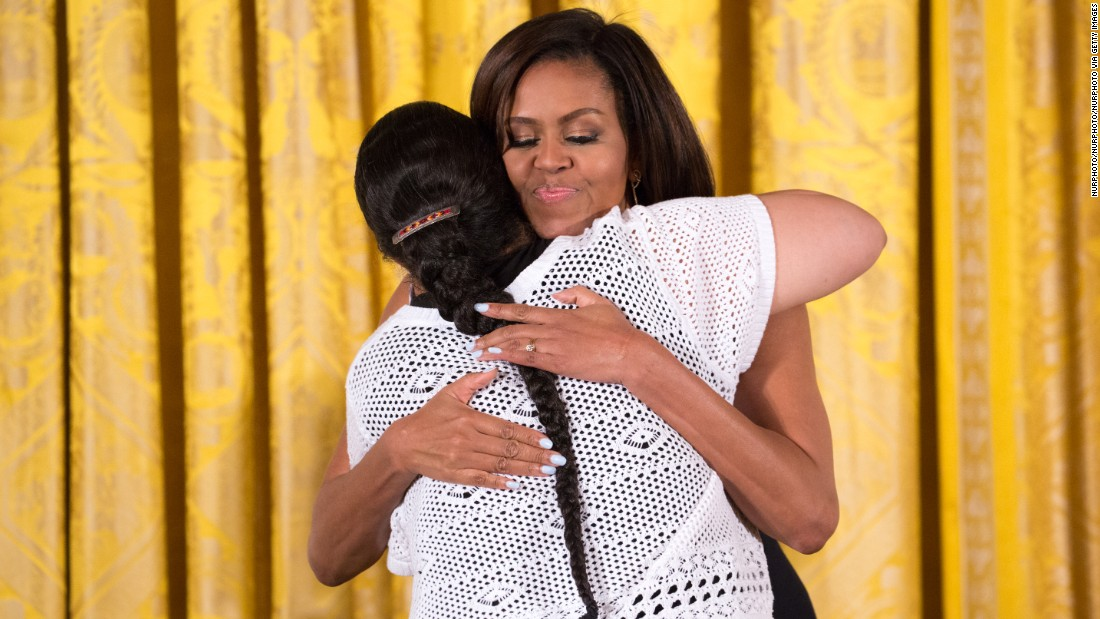 First lady Michelle Obama hugs Loren Spears, executive director of the Tomaquag Museum, during a White House ceremony on Wednesday, June 1. The Tomaquag Museum, which is dedicated to telling the story of Rhode Island's indigenous peoples, won a National Medal from the Institute of Museum and Library Services.