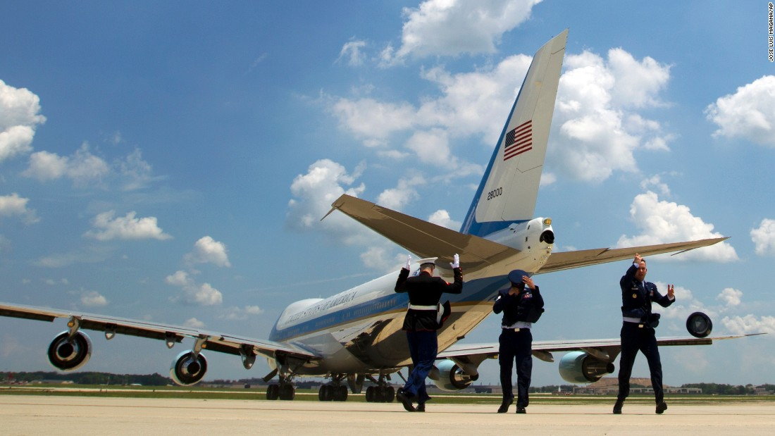 Air Force Col. Neal Bruegger loses his hat as Air Force One departs Andrews Air Force Base in Maryland on Wednesday, June 1.