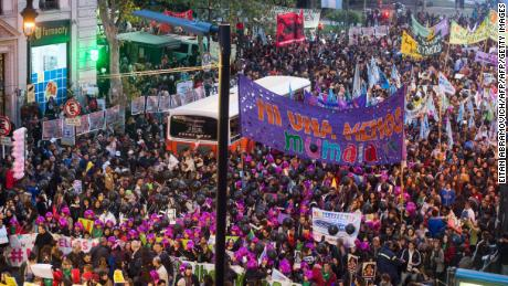 "People take part in the ""Ni una menos"" (Not One Less) march against femicides in Buenos Aires, on June 3, 2016. / AFP / EITAN ABRAMOVICH        (Photo credit should read EITAN ABRAMOVICH/AFP/Getty Images)"