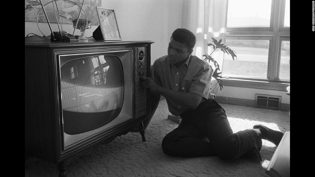 Ali watches TV in 1963.
