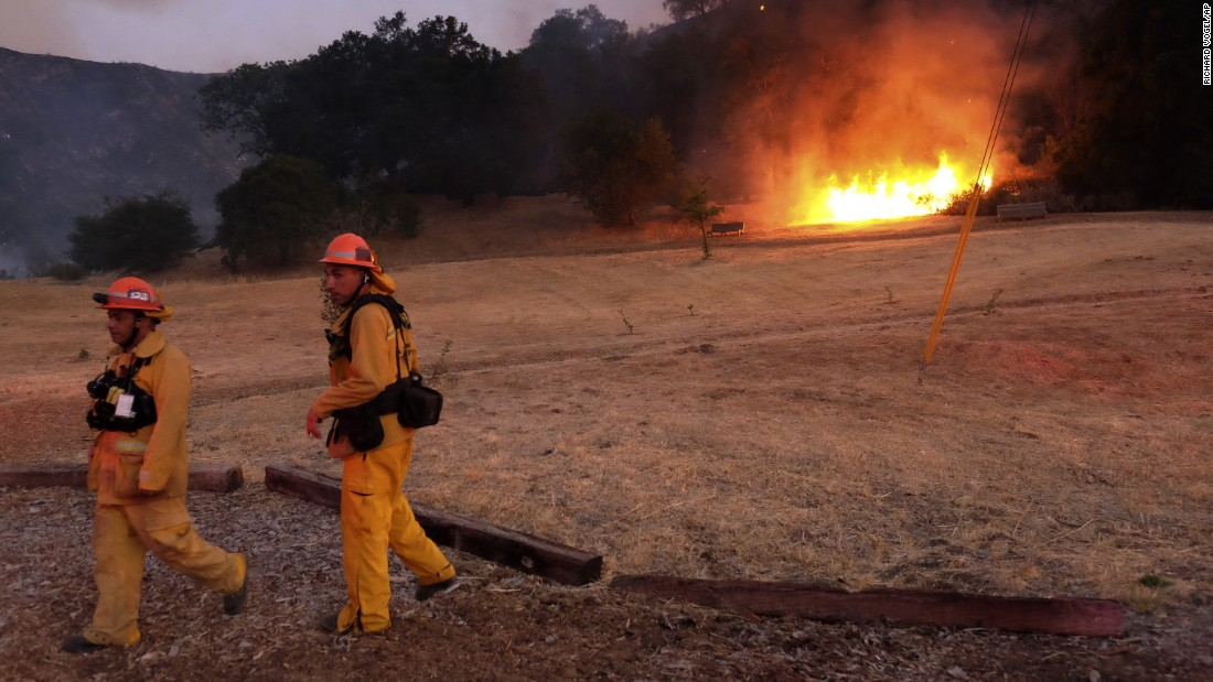 Los Angeles County firefighters confront a brush fire in the foothills outside of Calabasas on Saturday. More than 300 firefighters were battling the blaze, according to Los Angeles Fire Captain Roland Sprewell.