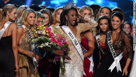 LAS VEGAS, NV - JUNE 05:  Miss District of Columbia USA 2016 Deshauna Barber (C) is surrounded by fellow contestants after she was crowned Miss USA 2016 during the 2016 Miss USA pageant at T-Mobile Arena on June 5, 2016 in Las Vegas, Nevada.  (Photo by Ethan Miller/Getty Images)