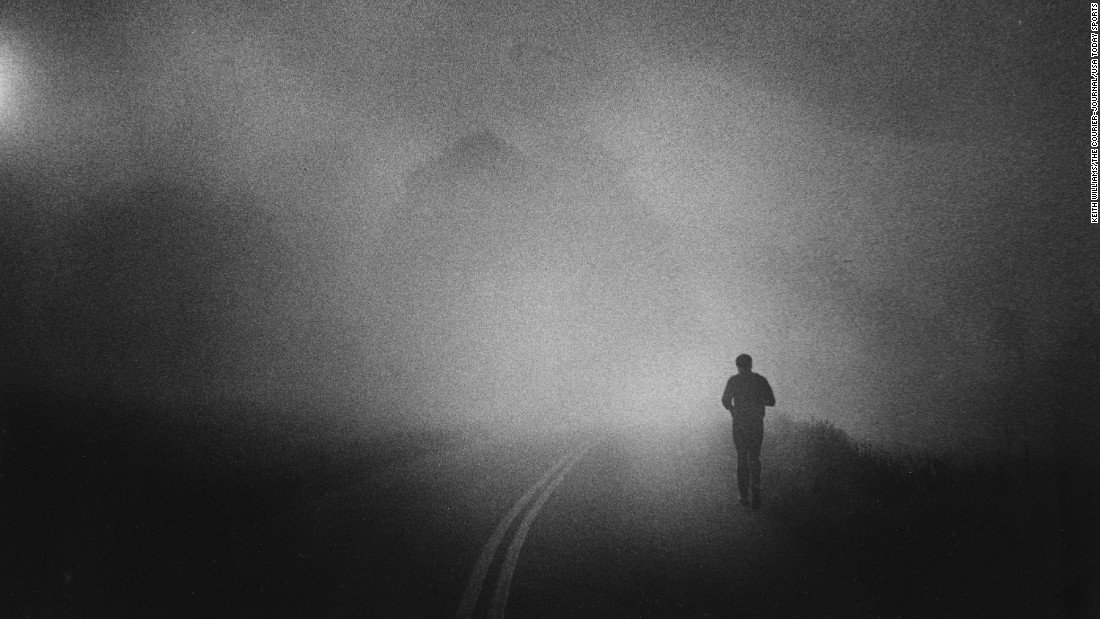 Ali takes his daily run along a Pennsylvania country road, shrouded in early morning fog, in 1978.