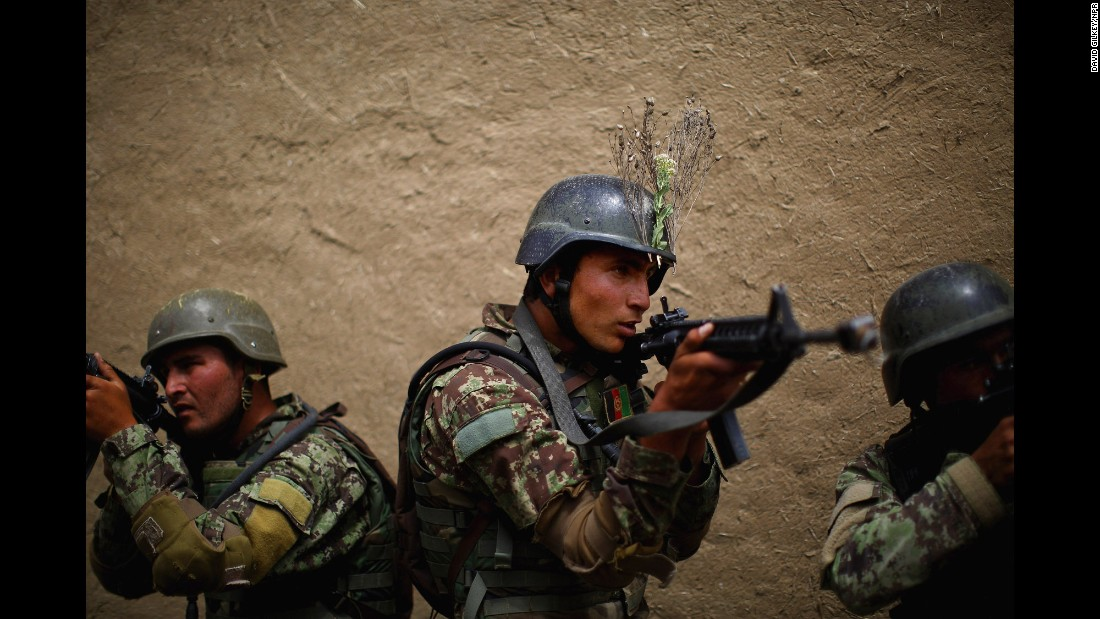 "This photo of Afghan commandos was taken last year by NPR's David Gilkey. The award-winning photographer and video editor was traveling in southern Afghanistan when he and fellow journalist Zabihullah Tamanna <a href=""http://money.cnn.com/2016/06/05/media/npr-photographer-david-gilkey-interpreter-killed-afghanistan/"" target=""_blank"">were killed</a> on Sunday, June 5. Gilkey was 50 years old. ""His photographs and videos were haunting in their beauty and poignant in their nuance,"" wrote <a href=""http://www.npr.org/2016/06/06/480866035/remembering-photojournalist-david-gilkey"" target=""_blank"">Ariel Zambelich,</a> an NPR colleague. ""Every person and every scene was captured with care, moving beyond the news to the personal struggle and perseverance of the people who lived it."""