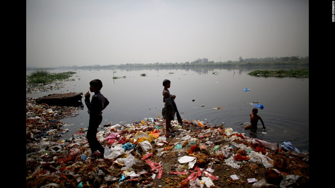 "Children who live along the banks of India's Yamuna River hunt for coins and anything valuable they can collect. The waters are polluted with heavy metals, raw sewage and industrial waste, according to <a href=""http://www.npr.org/2016/05/11/477415686/can-indias-sacred-but-dead-yamuna-river-be-saved"" target=""_blank"">an NPR report</a> earlier this year."