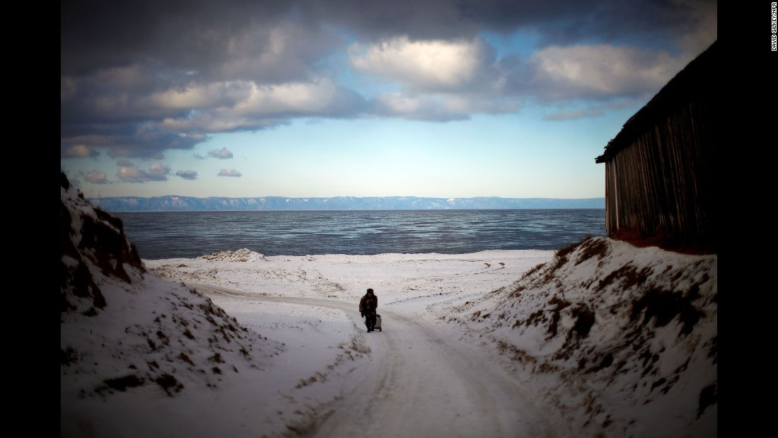 Storm clouds pass above a wintry landscape on the shores of Russia's Lake Baikal in 2012. It is the world's largest and oldest lake and holds nearly 20% of the world's fresh water.