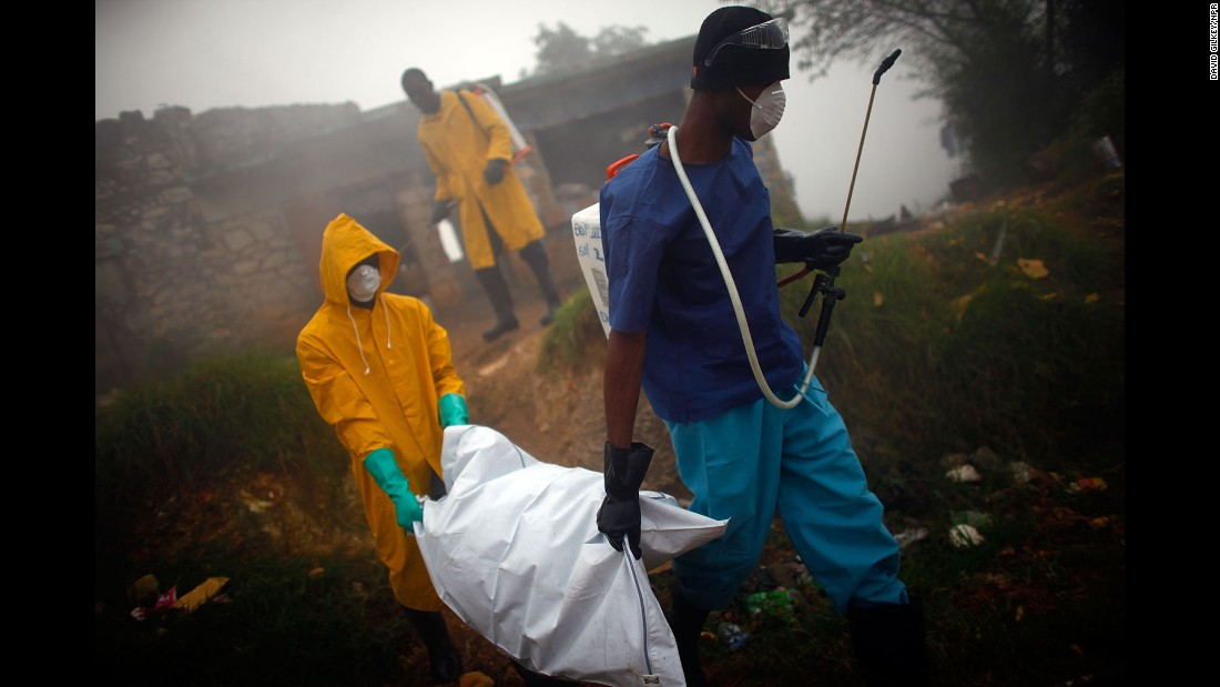 Health workers collect the body of a cholera victim in Petionville, Haiti, in February 2011.