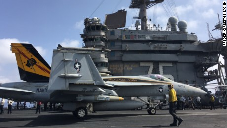 An F18 Hornet locked into the steam catapult shortly before being launched off the USS Harry Truman carrier