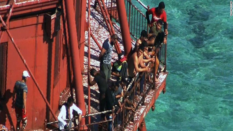 "The lighthouse Cuban migrants climbed is not ""dry land"""