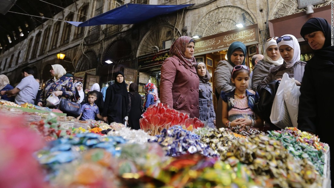 Women shop at a market in Damascus, Syria, on June 5.