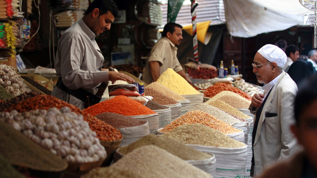 People shop for food at a market in Sanaa, Yemen, on June 5.