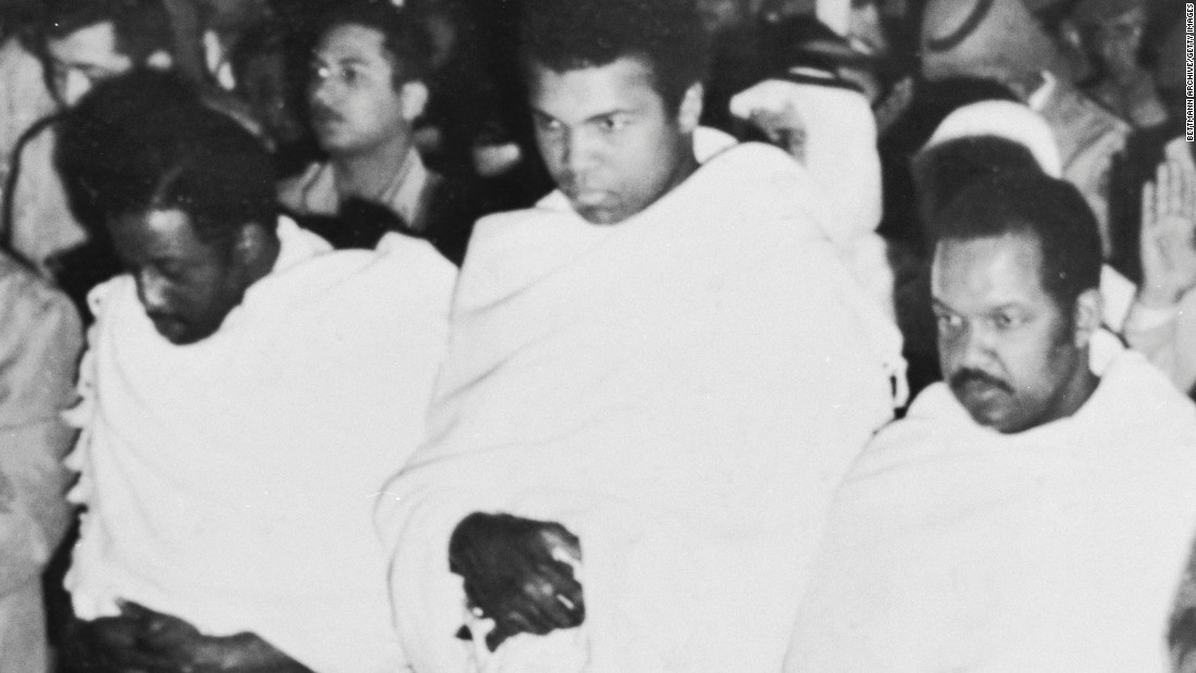 Flanked by fellow pilgrims, Muhammad Ali prays inside the Holy Mosque in Mecca during a January 1972 pilgrimage to the spiritual center of the Muslim world. After visiting the Prophet Mohammed's tomb in Medina, Ali said he became convinced that he could defeat Joe Frazier in a rematch.