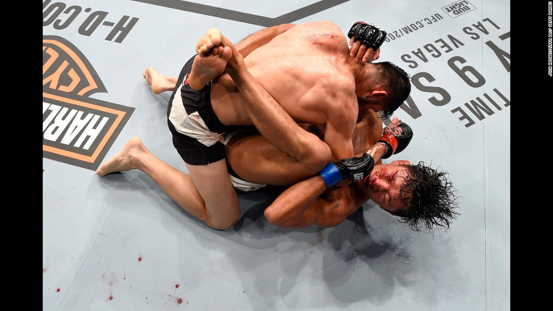 Polo Reyes, top, wrestles with Dong Hyun Kim during their lightweight bout at UFC 199 on Saturday, June 4. Reyes won with a third-round knockout.