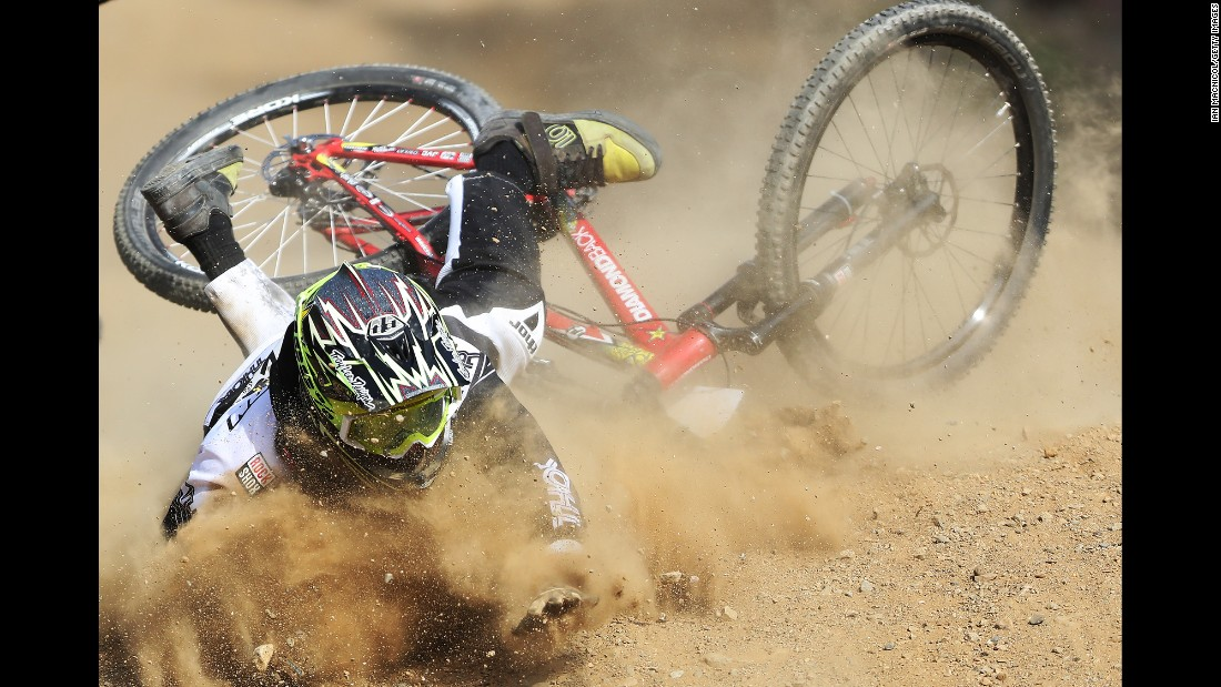 British mountain biker Jack Hudson crashes during the World Cup event in Fort William, Scotland, on Saturday, June 4.