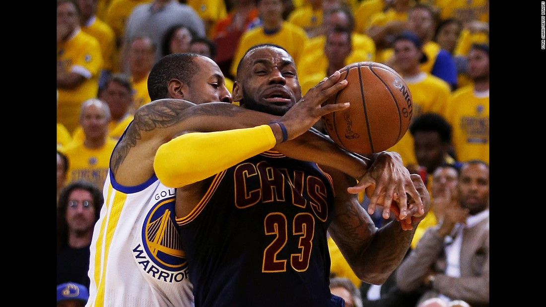 Cleveland's LeBron James is corralled by Golden State's Andre Iguodala during Game 2 of the NBA Finals on Sunday, June 7.