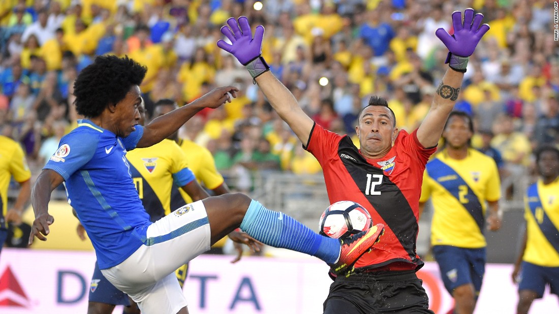 Ecuador goalkeeper Esteban Dreer blocks a kick by Brazil midfielder Willian during a Copa America match in Pasadena, California, on Saturday, June 4. The match ended scoreless.