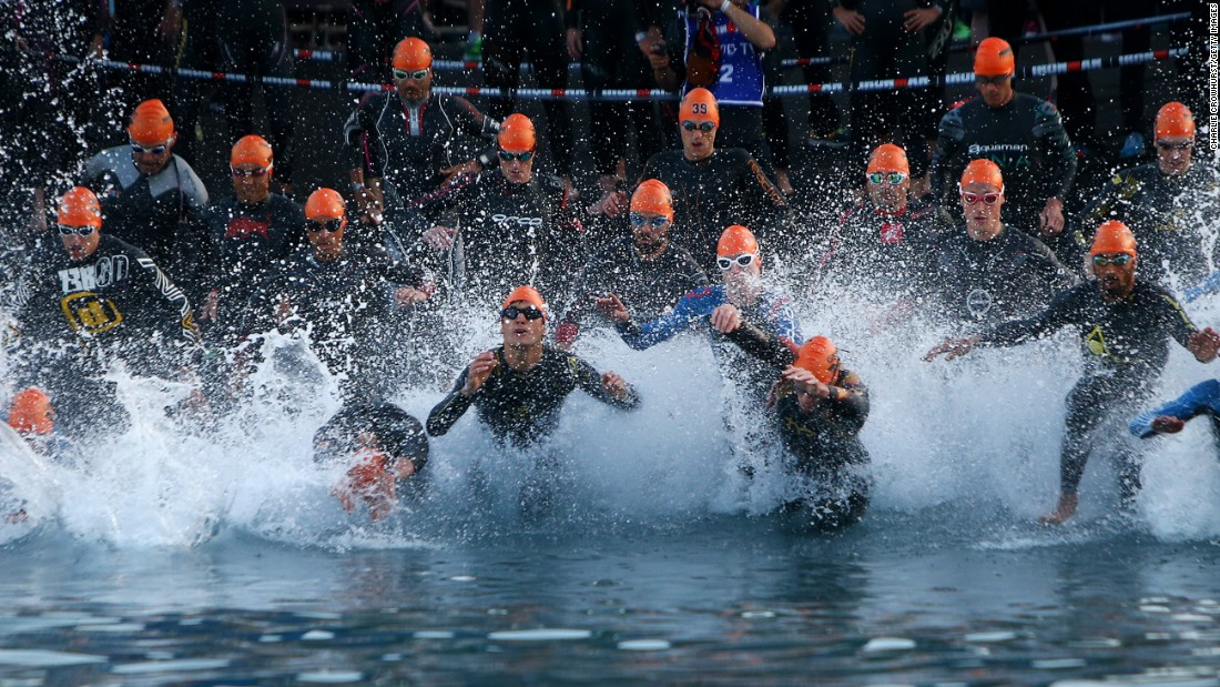Competitors begin the swimming leg of the Ironman race in Nice, France, on Sunday, June 5.