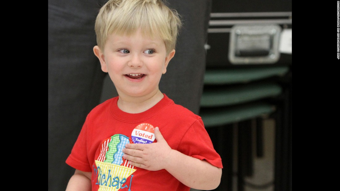 "Michael Held III, a 2-year-old from Biloxi, Mississippi, sports an ""I Voted"" sticker after he went to a voting location with his father on Tuesday, March 8. Many children across the country have accompanied their parents to the polls this year."