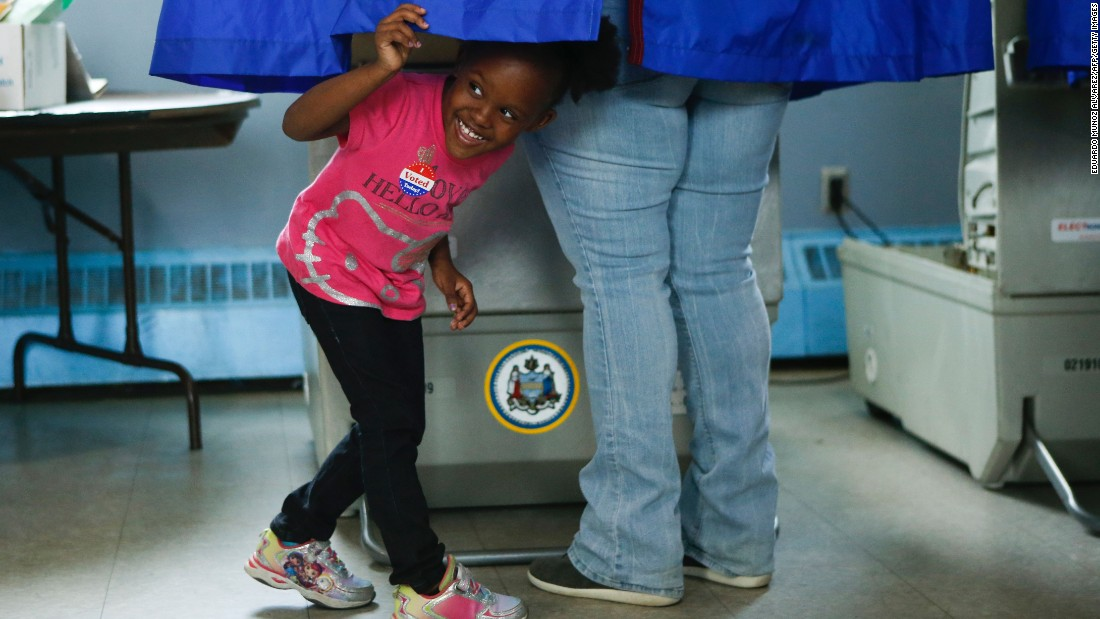 A girl looks out of a voting booth in Philadelphia on Tuesday, April 26.