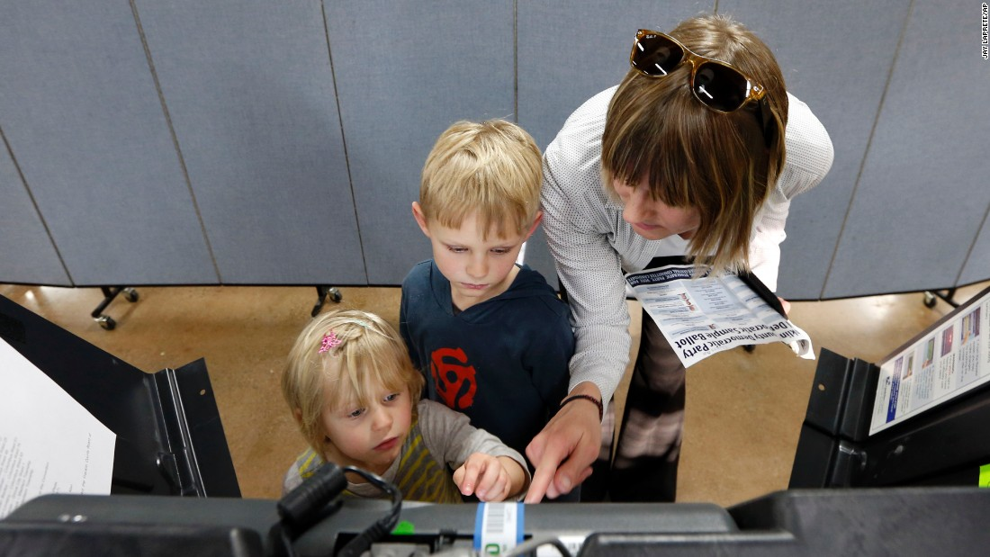 Liv Gjestvang brought her children Solveig, left, and Karsten as she voted in Columbus, Ohio, on Tuesday, March 15.