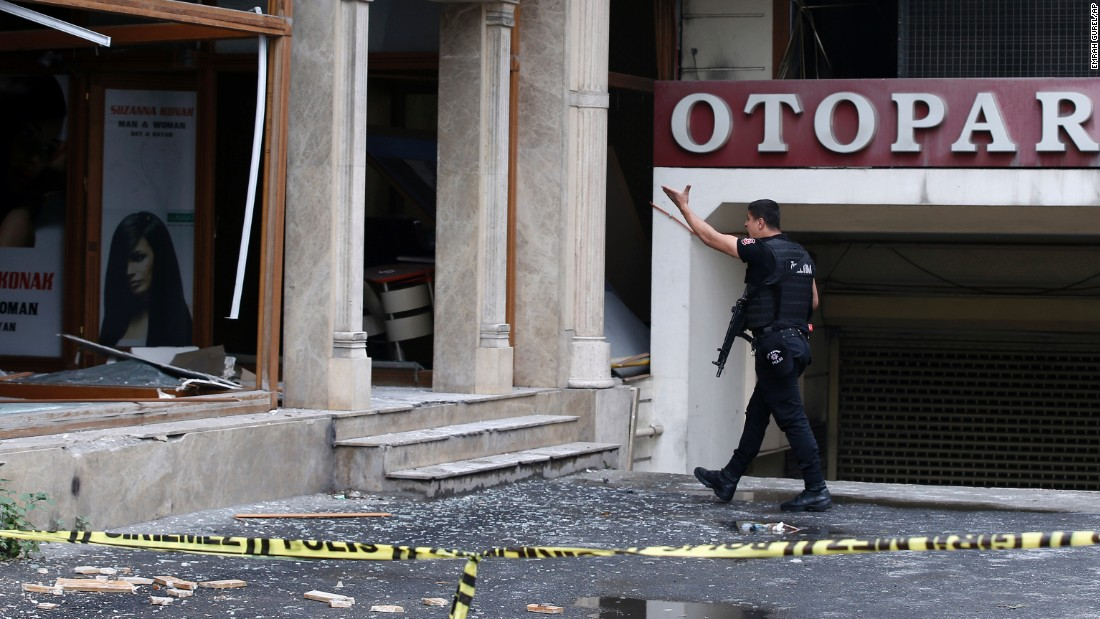 A police officer walks near the scene of the bombing, which happened during morning rush hour.