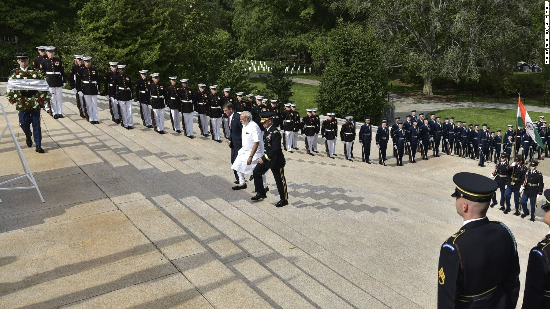 Modi, in white, arrives for a wreath-laying ceremony Monday, June 6, at Arlington National Cemetery in Arlington, Virginia.