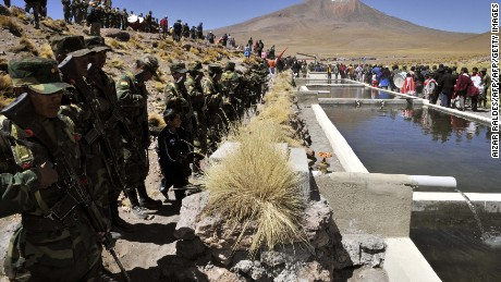 General view during the inauguration ceremony of breeding ponds for trouts --filled with water from the Silala river, on dispute with bordering Chile-- in Silala, southwest Bolivia on March 28, 2013.   AFP PHOTO / Aizar Raldes        (Photo credit should read AIZAR RALDES/AFP/Getty Images)