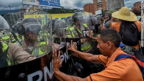 Demonstrators clash with police in an opposition march led by Miranda state Governor Henrique Capriles, as they are blocked from reaching the National Electoral Court in Caracas to demand validation of the signatures to initiate a recall referendum against President Nicolas Maduro, on June 7, 2016. / AFP / JUAN BARRETO        (Photo credit should read JUAN BARRETO/AFP/Getty Images)