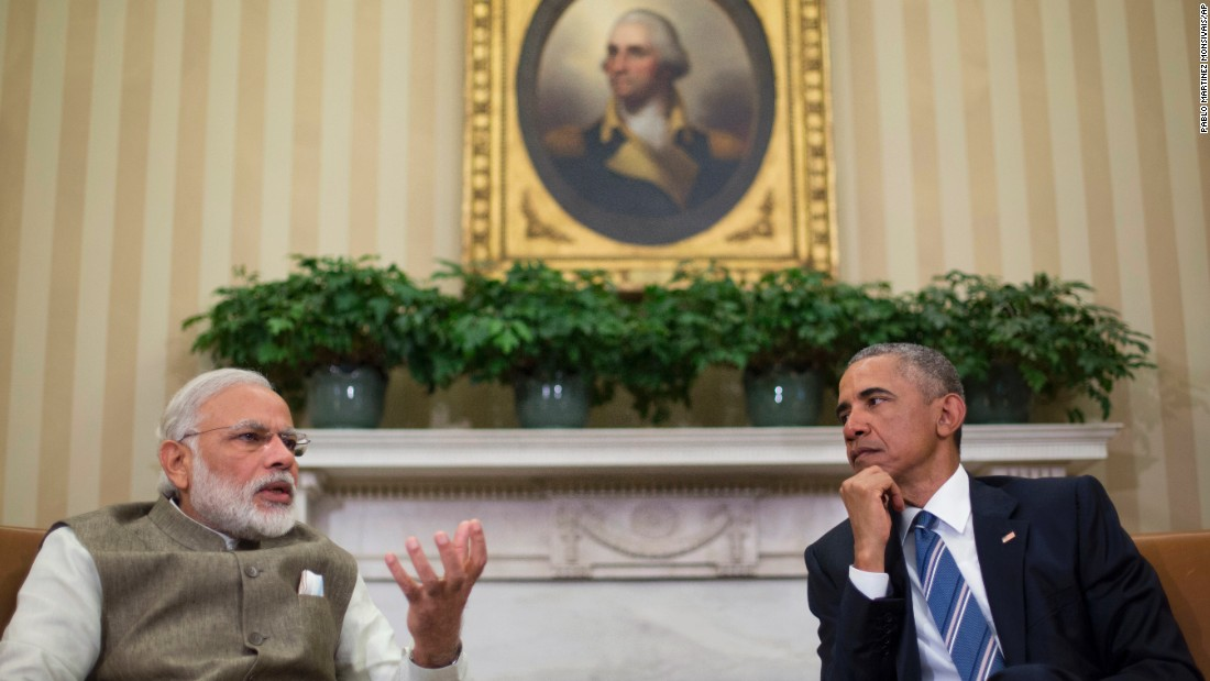 U.S. President Barack Obama listens to Modi during their meeting in the White House Oval Office on June 7.