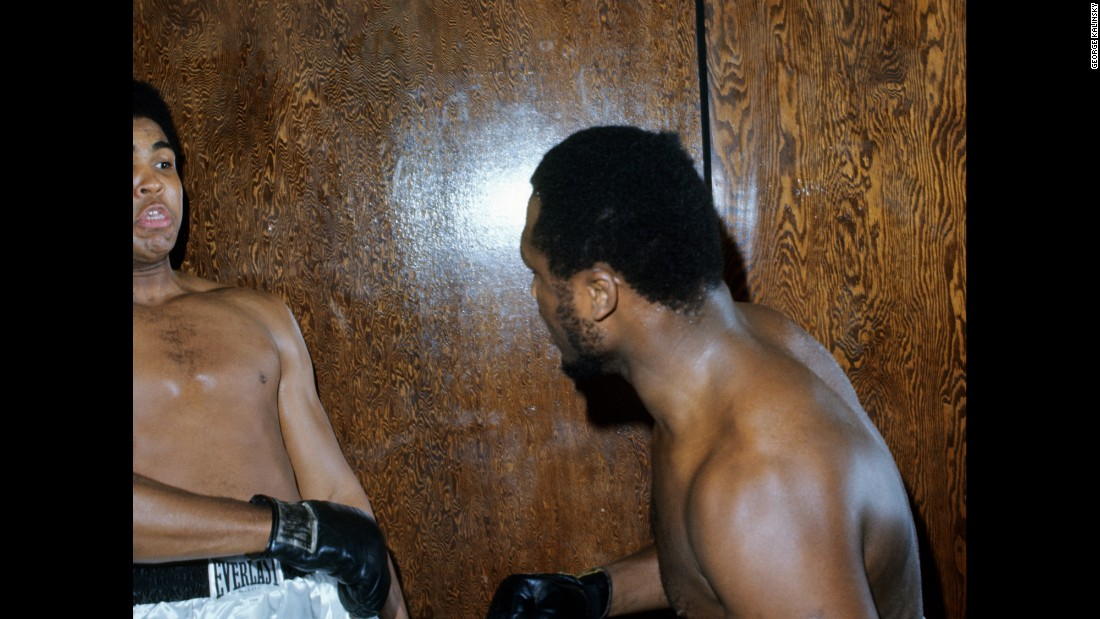 "The two boxers fooled around for the camera at Kalinsky's request. ""I said: 'Come on guys, you've got to make it look more realistic. Make it look like you're in the ring at the Garden, and I'll do what I have to do,' "" Kalinsky recalled. ""And they started jabbing a little bit, and Joe hits Ali in the stomach with a huge left and Ali goes down. ... Ali looked up at Joe and said, 'You son of a gun can really hit.' And Joe looks at Ali and he said: 'That's the way it's going to be the night of the fight.' "" Frazier, of course, would go on to win the fight and hand Ali his first professional loss."