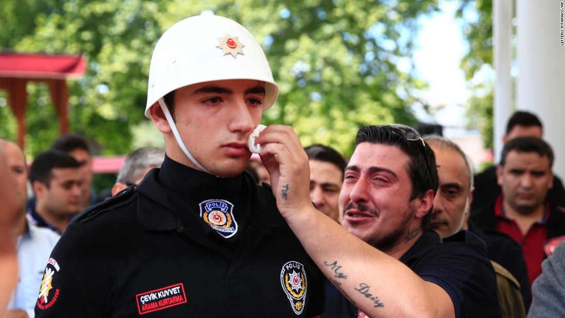 "A relative of a car-bombing victim wipes the face of a police officer during a funeral procession in Istanbul on Wednesday, June 8. At least 11 people were killed and 36 were injured when <a href=""http://www.cnn.com/2016/06/07/europe/gallery/istanbul-bus-bomb/index.html"" target=""_blank"">a car bomb targeted a police bus</a> the day before."